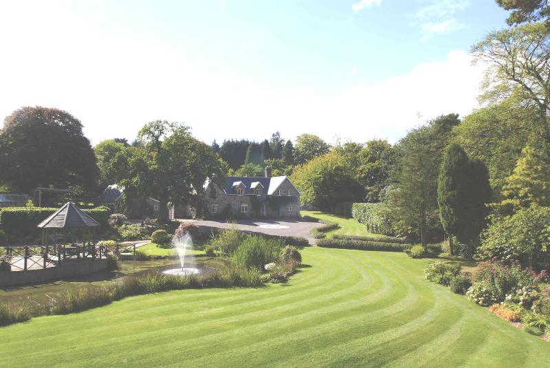 Widcombe Grange across the sweeping lawn, beside the lake - Widcombe Grange - Culmhead - rentals