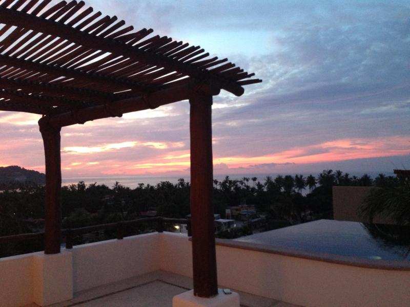Sunset from rooftop infinity pool w/panoramic ocean view - Amazing Oceanview Sayulita Getaway - Sayulita - rentals