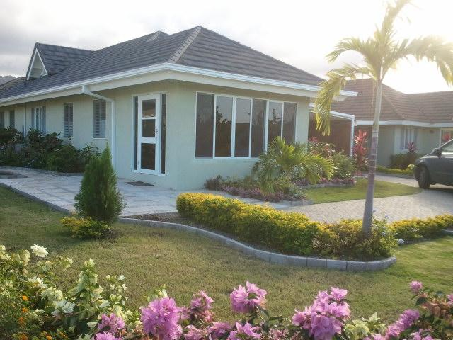 FRONT VIEW OF VILLA WITH A MESHED PATIO WITH TINTED WINDOWS - 3 BD VILLA  INCLUDES HOUSEKEEPER/AIRPORT TRANSFERS - Priory - rentals