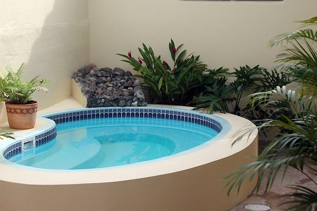 Enjoy the shared jacuzzi in our back patio al fresco! - Beach Vacation in Our Comfy Studio! - San Juan - rentals