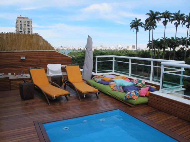 DECK VIEW: IMPERIAL TREES OF BOTANIC GARDEN, LAGOON AND IPANEMA AND LEBLON BACK - Panoramic, Luxury Triplex Penthouse  Deck Pool & Sauna! - Rio de Janeiro - rentals