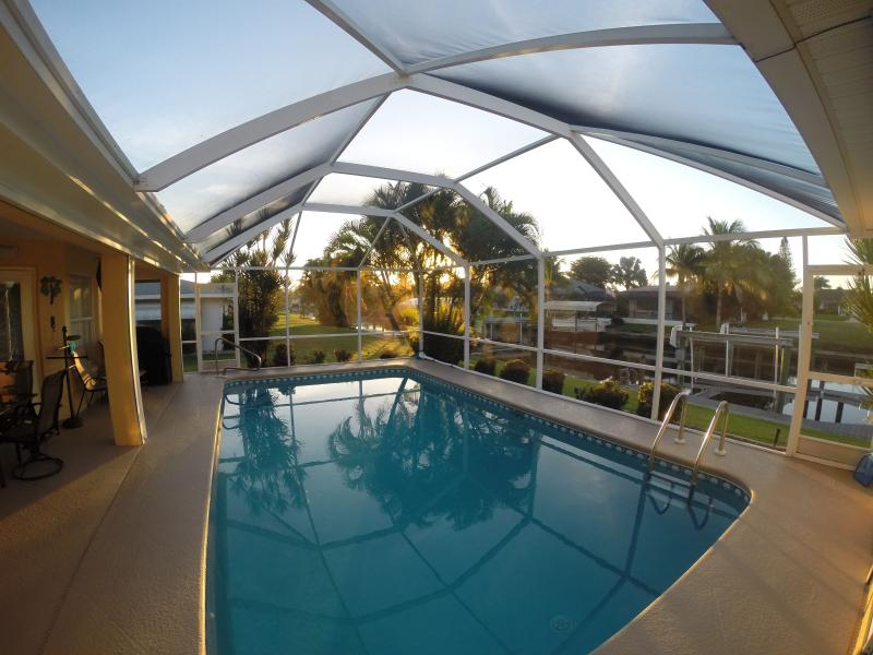 Sunrise on the lanai - so nice to wake up to ! - Villa Leonardo - Heated Pool, Canal Access w/Boat Lift, 4 bdrms, Sleeps 10+ - Cape Coral - rentals