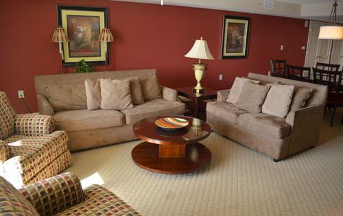 Spacious living area with balcony access - Great 2BR condo, huge pool/WiFi, Yacht Club 2-502 - North Myrtle Beach - rentals