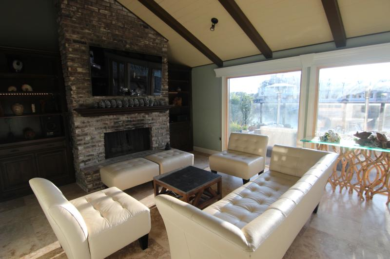 Living room with stereo, 65 inch TV and fireplace - Waterfront home in Huntington Harbour - Huntington Beach - rentals