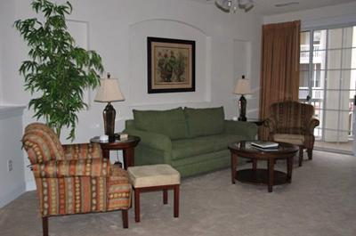 Living room with balcony access - Pristine 3BR Greenbriar 421 @ Barefoot Resort!!! - North Myrtle Beach - rentals
