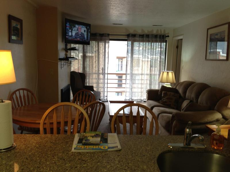 Open kitchen and living room with plenty of natural light - Top Floor Park City Condo with Views of the Slopes - Park City - rentals
