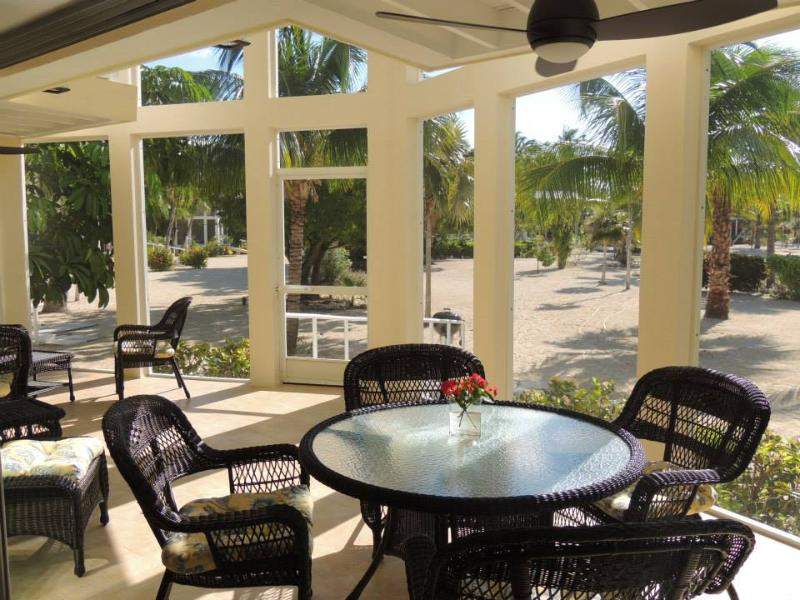 The large lanai with its view of the beach and cove - Starboard Kai Beachfront Home Rum Point Cayman Kai - Grand Cayman - rentals