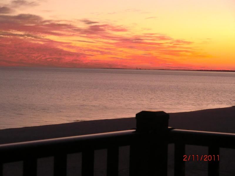 Sunset view from private balcony - Pass Christian 100% Beachfront Luxury Condo - Pass Christian - rentals