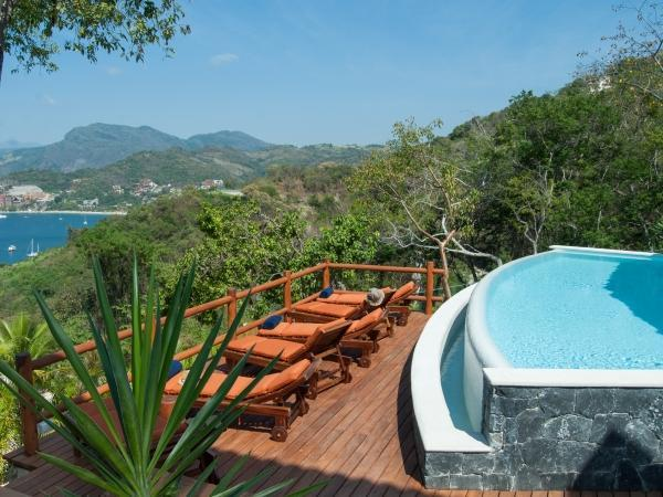 Our pool and sundeck from the Pinzan room - B&B Hillside Retreat with stunning bay views - Zihuatanejo - rentals