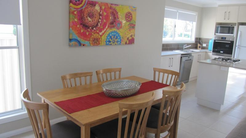 Open plan living/dining area which opens out onto a private courtyard with electric BBQ - Spacious New Dalby Apartments Centrally Located - Dalby - rentals