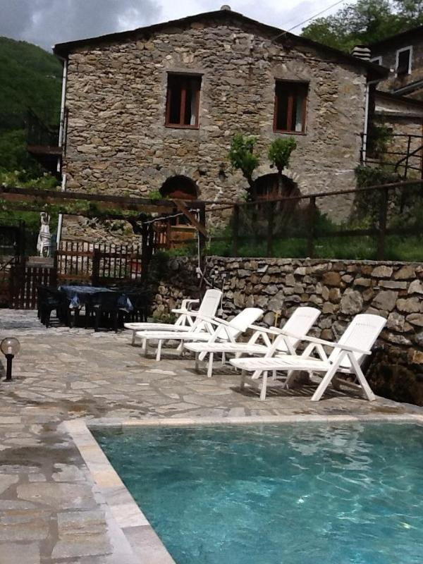 Mill house from pool - large River-side stone mill with swimming pool - Agaggio Inferiore - rentals