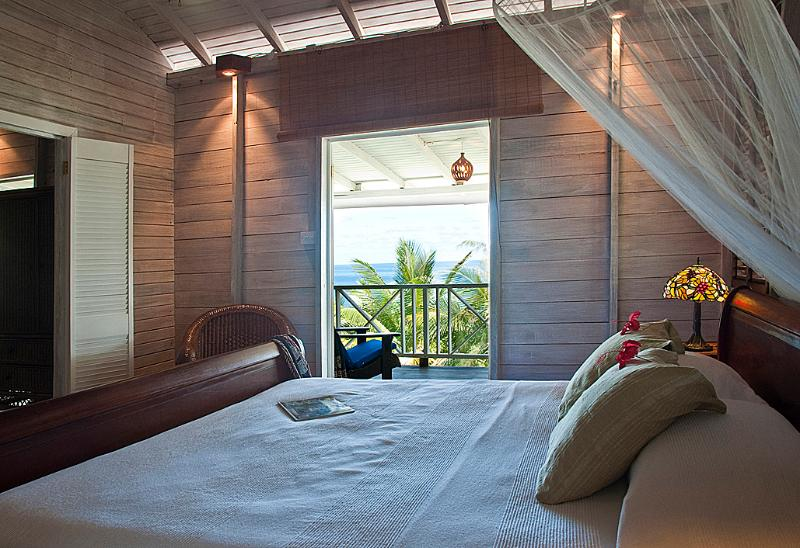 Bedroom with sleigh king bed - Owner Suite at Sea-U Guest House - Bathsheba - rentals