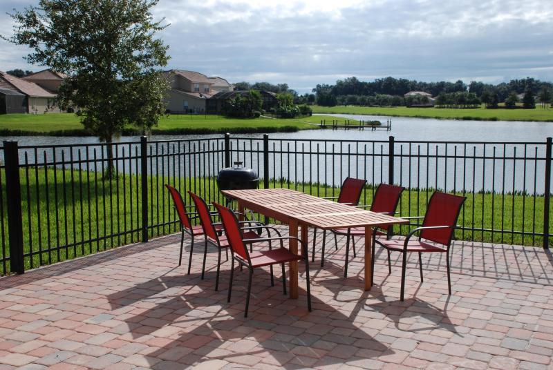 Patio Overlooking Lake - Home on Lake Bellalago w/ Tohopekelaga access - Kissimmee - rentals