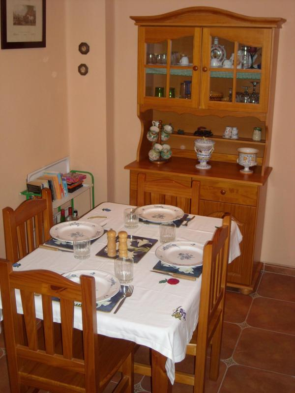 Dining area table prepared for dinner - Family Friendly Cheerful Apartment In Valencia - Valencia - rentals