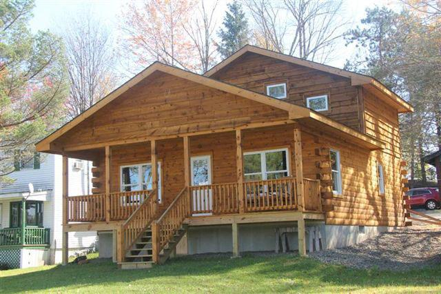 log cabin with covered porch overlooking lake - New Log Cabin on Duck Harbor waterfront - Equinunk - rentals