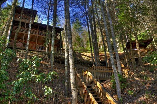 Above the River- 2BR/2BA- CABIN WITH TOCCOA RIVER ACCESS, SLEEPS 6, DECK ACCESS FROM EACH BEDROOM, GAZEBO OVERLOOKING THE WATER, HOT TUB, FOOSBALL, PING PONG, GAS LOG FIREPLACE AND WIFI! STARTING AT $135 A NIGHT! - Image 1 - Blue Ridge - rentals