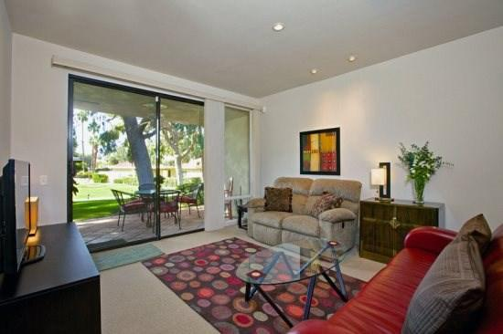 Comfortably Furnished Living Room Looking to Patio - Sunrise Alejo Upgraded Two Bedroom Condo - Palm Springs - rentals