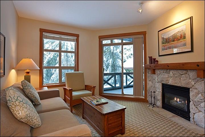 Modern and Simple Living Room Features a Cozy Stone Fireplace - Lovely Golf Course and Forest Views - Located on Free Shuttle Route (4030) - Whistler - rentals