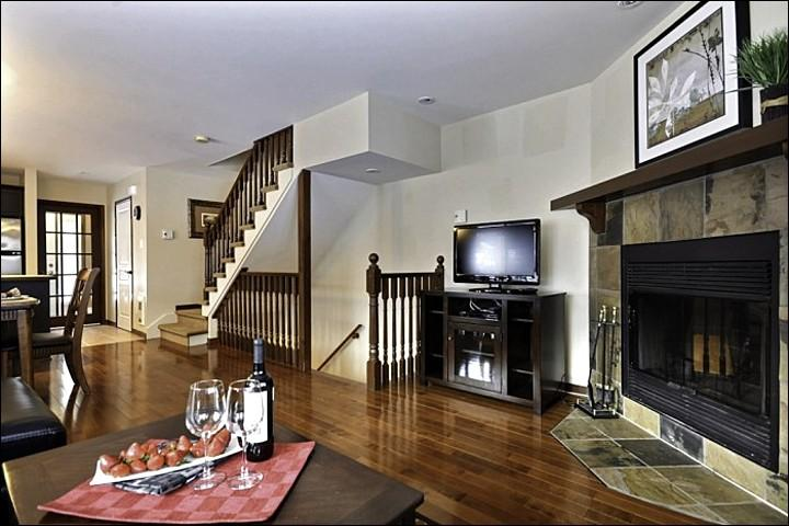 The Large Living Area Offers you Beautiful Hardwood Floors, a Cozy Wood Burning Fireplace, and a Open Concept Feel - Breathtaking Views of the Mountains and Golf Course - Cozy Wood Burning Fireplace (6003) - Mont Tremblant - rentals