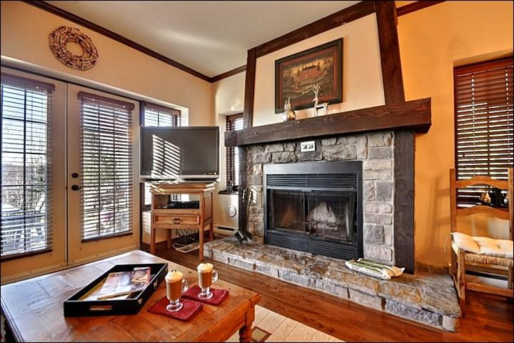 Elegant Living Room Features a Stone Fireplace and Flat Screen TV - Expansive Forest View - Walking Distance from the Village (6021) - Mont Tremblant - rentals
