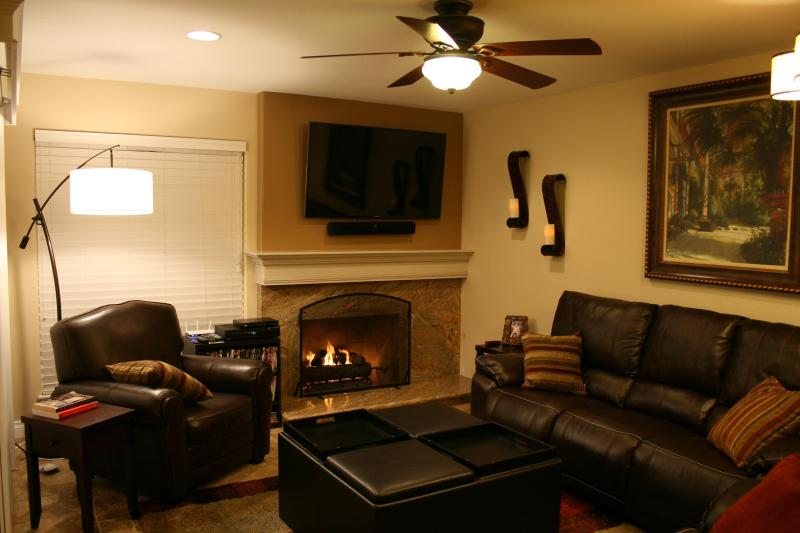 Living room/lounge. Every seat reclines, and there's a reading nook by the fire. - A Great Place to Relax -- Extended Vacations & Short-Term Executive Home - Garden Grove - rentals