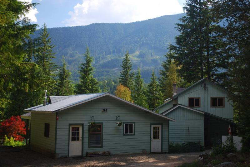 Looking south west toward Slocan Lake (before external redecoration) - Cozy suite rental in Hills, West Kootenay, BC - New Denver - rentals