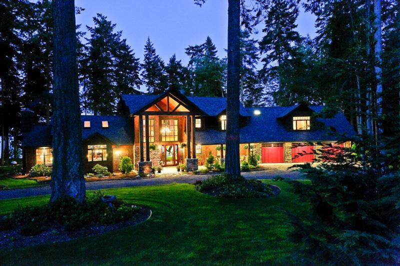Soaring Eagle Lodge on Whidbey Island at twilight. - Luxury Waterfront Lodge, Hot Tub, Eagles, WiFi - Whidbey Island - rentals