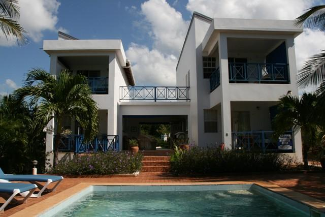 view from the garden to the house - MARBLUE. the Collection/ Domicil Beach House - Treasure Beach - rentals