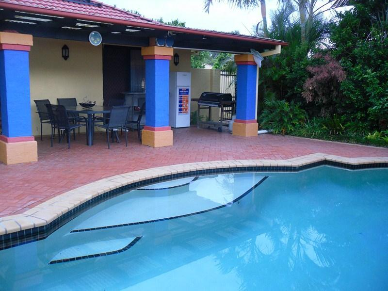 Private pool terrace with barbeque and outside fridge. The pool is heated! - Lemongrove Rd: Exec 4 bed home + pool, Birkdale - Brisbane - rentals