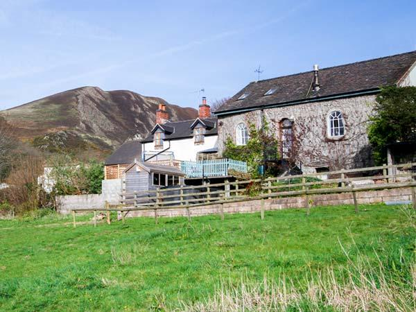 THE OLD CHAPEL, 19th century, semi-detached cottage, woodburning stove, private hot tub, in Church Stretton, Ref 30035 - Image 1 - Snailbeach - rentals