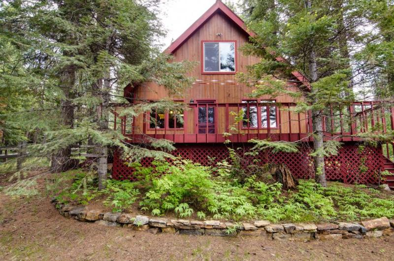 A peaceful, rustic cabin with a tree-lined deck, yard, and outdoor firepit! - Image 1 - McCall - rentals