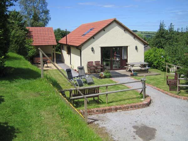 WALNUT COTTAGE, barn conversion, all ground floor, hot tub, parking, garden, in Washford, Ref 913786 - Image 1 - Washford - rentals