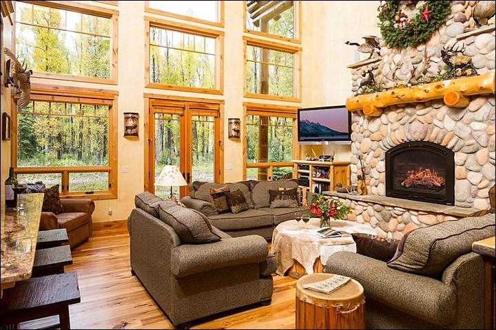 Open Living Room Boasts Wood and Stone Finishes and Wonderful Forest Views - Expansive Home with Gourmet Kitchen - Steps from the Snake River and Trails (6961) - Wilson - rentals