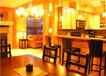 SELKIRK ONE: Enjoy the open kitchen concept, living room with fireplace and dining table - Selkirk One - Golden - rentals