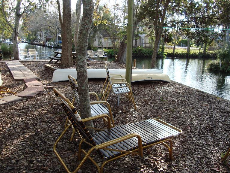 Back yard shows canoes outdoor seating seawall has two docks all waterviews - Waterfront-Take Me To The River-2.5 baths sleeps 8 - Weeki Wachee - rentals