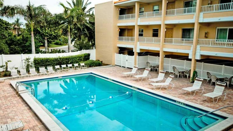 Plenty of Seats to Enjoy the Sun - Gulf Sands: 2BR Flip-Flop Ready Beachfront Condo - Holmes Beach - rentals