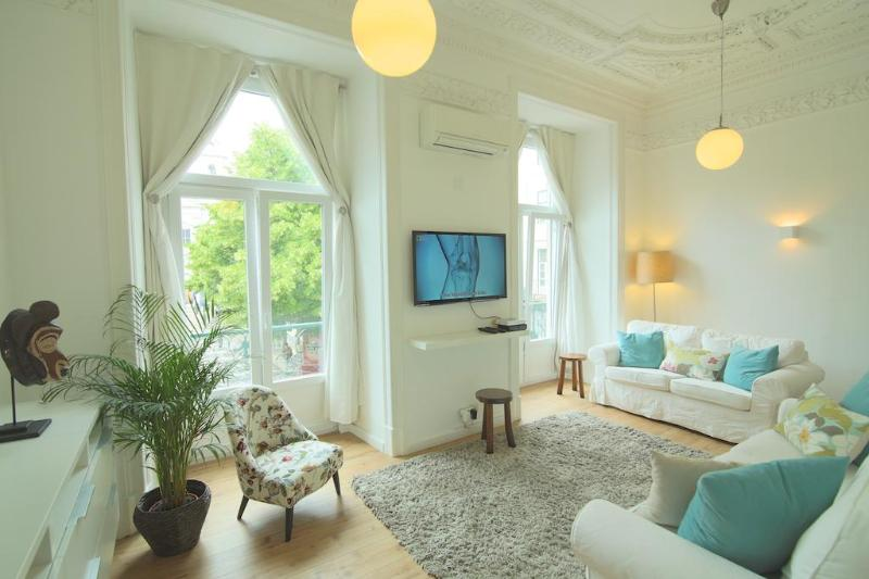 Living room has abundant light as it has 2 full windows out to small balconies overlooking square - Praca Sao Paulo / Historic Centre (free WIFI) - Lisbon - rentals