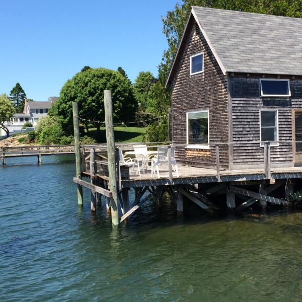 The incoming tide laps the piers under the cottage. - The Fish House Cape Porpoise Harbor, Kennebunkport - Cape Porpoise - rentals