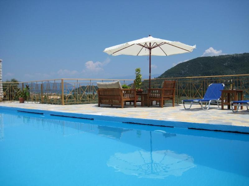 Private stone villa with prvate swimming pool panoramic sea and bay views, bbq, near Nidri - Image 1 - Lefkas - rentals