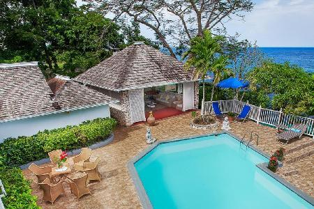 Cliffside Lime Tree offers ocean views, freshwater pool & grotto, kayak, and full staff - Image 1 - Ocho Rios - rentals