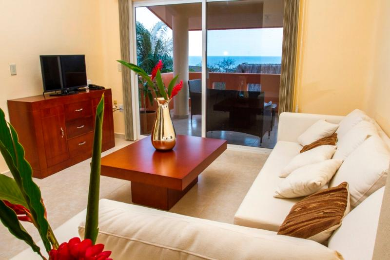 Open living room with walk out to private oversized balcony - NEW 2 bdrm condos steps  from Manzanillo beach - Puerto Escondido - rentals