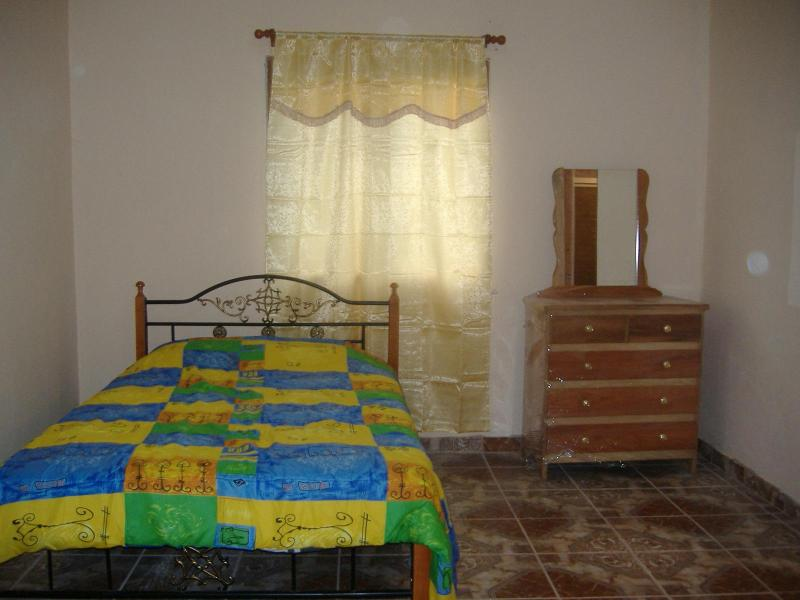 Master bedroom with a spacious private bathroom with a walk-in jacuzzi-style bathtub - Internet/Cable TV Fantastic Views Affordable  Flat - Volcan - rentals