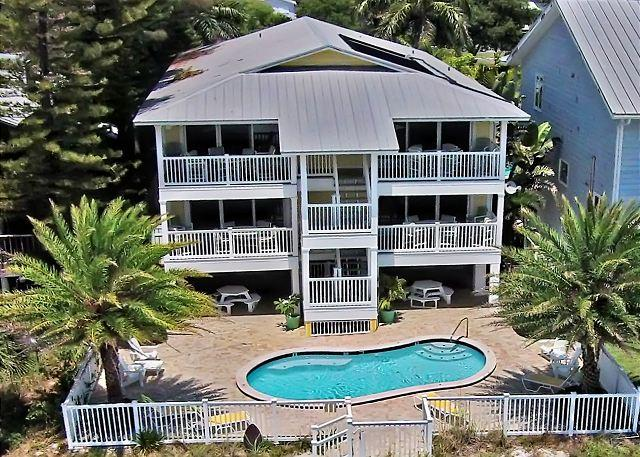 Aerial View - Sunset Villas exterior facing the Gulf of Mexico with pool beach side. - Sunset Villas Unit #2 - Redington Shores - rentals