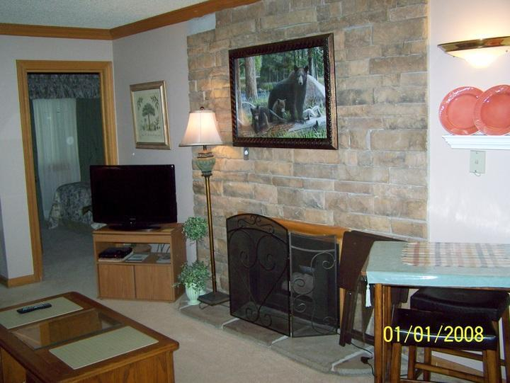 Condo Living Room with River Stone Fireplace - Gatlinburg Chateau - 2 Bedroom Condo (408) - Gatlinburg - rentals