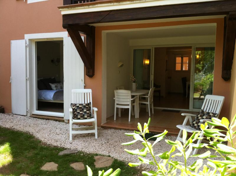 bedroom opens on to the garden - apartment in a holiday village, wave pool, and spa - Grimaud - rentals