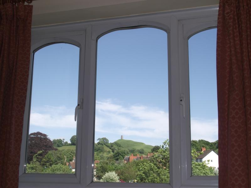 The stunning view of Glastonbury Tor from the sitting room at Oriel Drive Glastonbury - Oriel Drive, Glastonbury Centre, view of The Tor. - Glastonbury - rentals