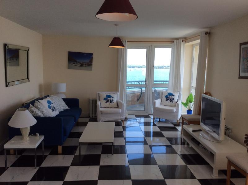 Living room and door to balcony - Harvey's Waterfront - Herons Landing Sleeps 7 - Youghal - rentals