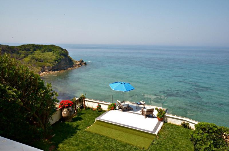sun deck above the sea - SEAHORSE BEACH VILLA - pool & steps down to sea - Corfu - rentals