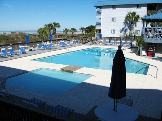 Enjoy watching dolphins in the river, shrimp boats  cargo ships entering  leaving the Port of Savannah, the swimming pool  tennis courts - Savannah Beach & Racquet Club Condos - Unit A316 - Panoramic Water View - Swimming Pool - Tennis - Tybee Island - rentals