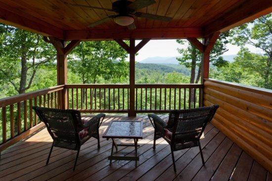 Spectacular view from the deck overlooking the mountaintops - Sunrise Retreat - Ellijay GA - Ellijay - rentals